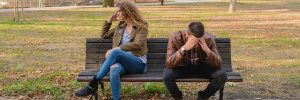 Couple Sitting on Park Bench experiencing a relationship breakdown